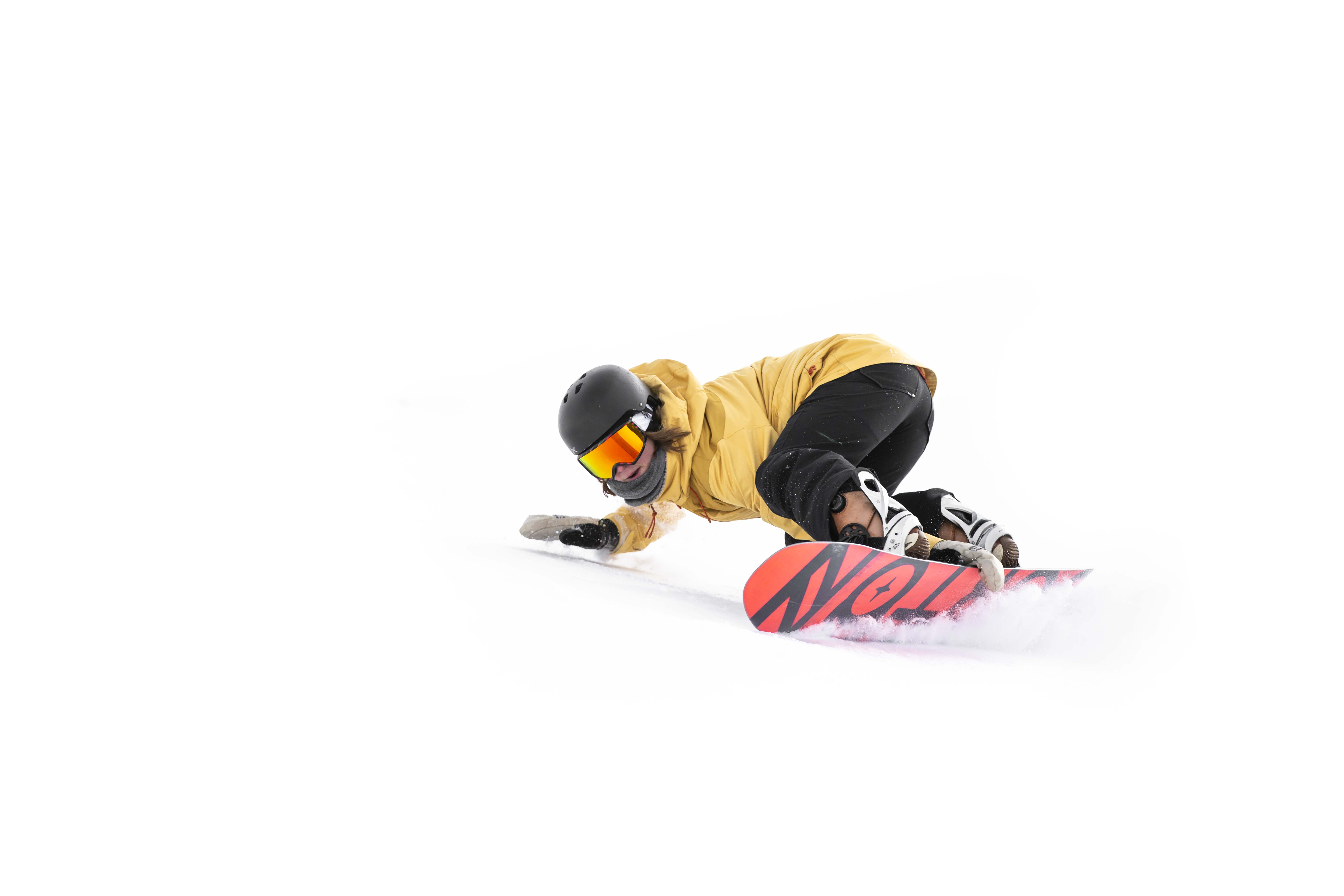 snowboarder carving at cardrona alpine resort