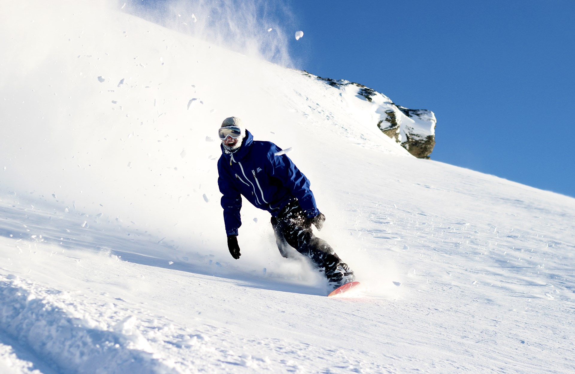 Snowboarder making powder turns