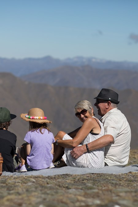 family picnic with view of southern alps at cardrona